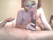 Masked white milf sucking a black man
