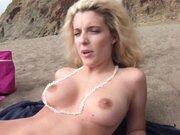 Superb nudist blonde filmed at the beach