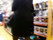 Exhibitionist woman flashing in public stores