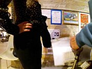 Nude exhibitionism at museum with a sweetheart woman flashing at candid camera